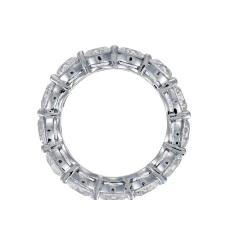 Platinum Diamond Eternity band, features 13 GIA Round brilliant cut diamonds, collection color and quality. Total diamond weight is 13.14 Carats, Each stone comes with GIA Certificate, D-E-F in color VVS-VS in clarity. Ring size 6