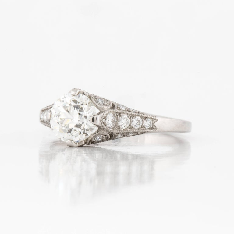 This ring is set in platinum with a 0.98 carat diamond in the center.  It is I in color and SI1 in clarity.  Side pave' stones have a total carat weight of 0.37.  Center stone is GIA certified, certificate 5171117611.  Presentation area is 9/16
