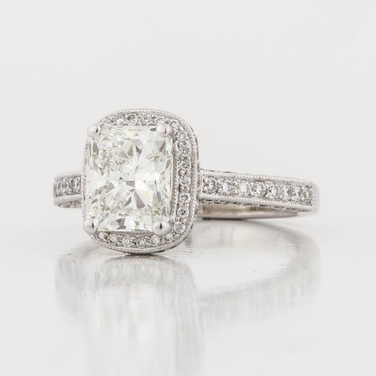Diamond ring set in platinum.  Diamond is 2.01 radiant cut, I in color and VS2 in clarity.  GIA Report 2173495509.  In addition, there are 136 round diamonds totaling 2.05 carats which are G-H in color and VS1-VS2 in clarity.  Presentation area is