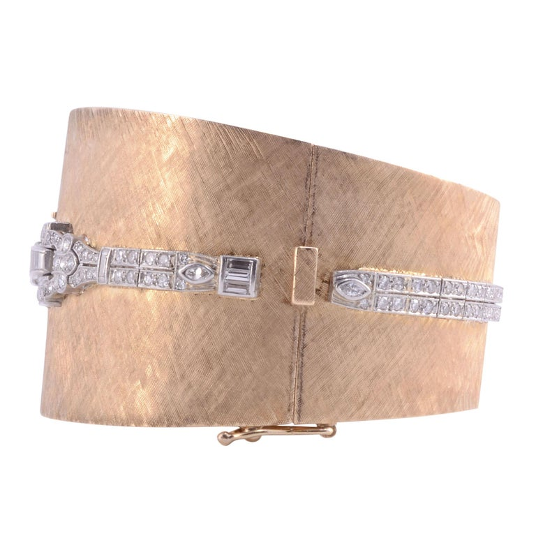 Estate platinum gold & diamond cuff bracelet wrist watch. This ladies cuff wrist watch is crafted in 14 karat yellow gold and platinum with 2.65 carat total weight of diamonds. The diamonds have VS2 clarity and G color. This bracelet has 37.5 grams