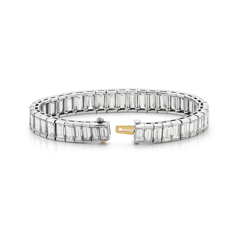 This bracelet features 38 carats of F-G VS graduated baguette cut diamonds set in platinum. This bracelet is made by the highest quality Italian craftsmans making it extremely flexible with soft delicate movements. Hidden clasp closure. 7 inch