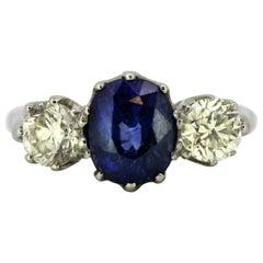 Platinum Ladies Three-Stone Ring with Natural Blue Sapphire and Diamonds