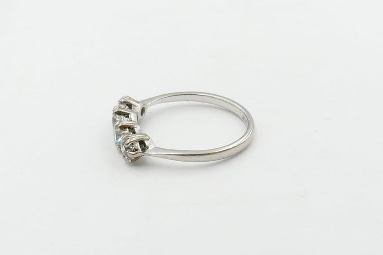 This lovely old Platinum Eternity Ring is made up of 5 Old European Cut Diamonds Colour F/G, Clarity VS2-SI1 and are Claw Set. The Band is polished, low half round, tapered, slightly upswept to a basket underrail & measures 1.93mm wide at the base