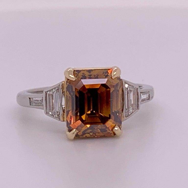 Modern Platinum Natural Emerald Cut Diamond Ring GIA 3.37 Carat Fancy Deep Orange-Brown For Sale
