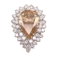 Fancy Yellow Brownish Pear Shape Diamond Ring With Double Halo in  Platinum