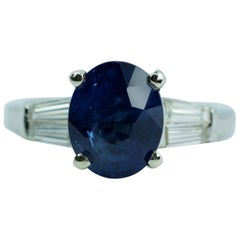 Platinum Oval Ceylon Blue Sapphire and Tapered Baguette Diamond Ring