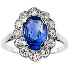 Platinum Oval Ceylon Sapphire and Semi Modern Cut Diamond Scalloped Cluster Ring