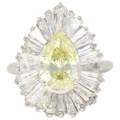 Platinum Pear and Baguette Diamond Ballerina Ring with Yellow Diamond Center