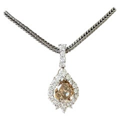 Platinum Pendant with Chain Set with a Pear Shape Champagne Diamond