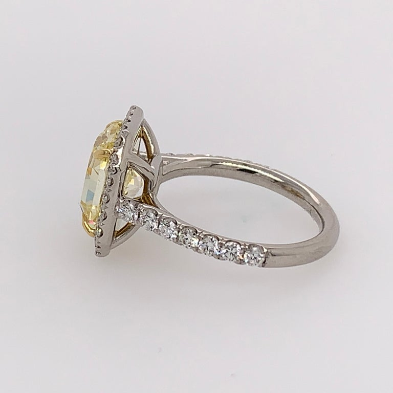 Modern Platinum Ring 4.05 Carat GIA Internally Flawless Radiant Natural Fancy Yellow For Sale