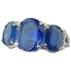 Platinum Ring with 3 Large Oval Cut Blue Sapphires and Diamonds