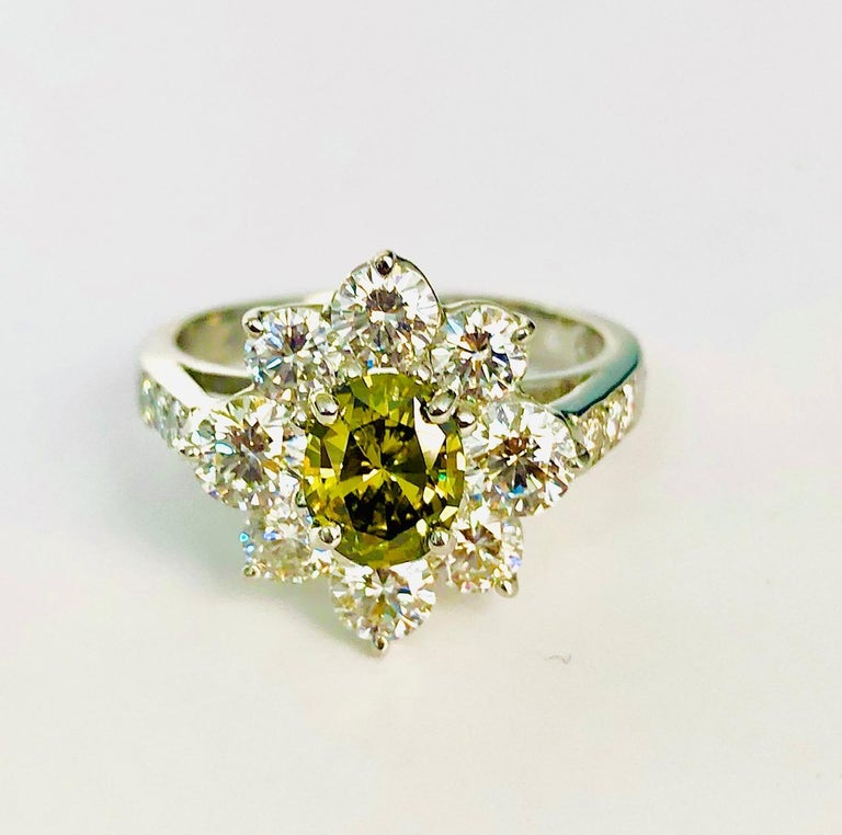 Oval Cut Platinum Ring with a Natural Color Oval Diamond, with GIA Report For Sale