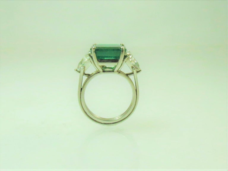 Women's  Columbian Emerald Cut Emerald and Triangular Diamond Platinum Ring For Sale