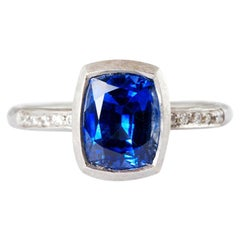 Platinum Ring with Cushion Shaped Sapphire 3.05 Carat and Channel Set Diamonds