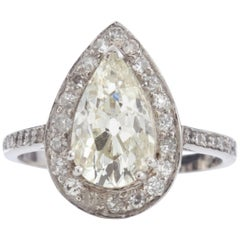 Platinum Ring with Pear Cut Diamond of 2.4 Carat and Surrounding Diamonds
