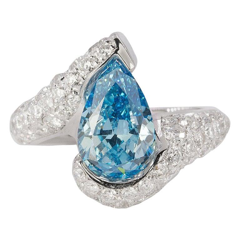 Platinum Ring with Vivid Blue Diamond For Sale
