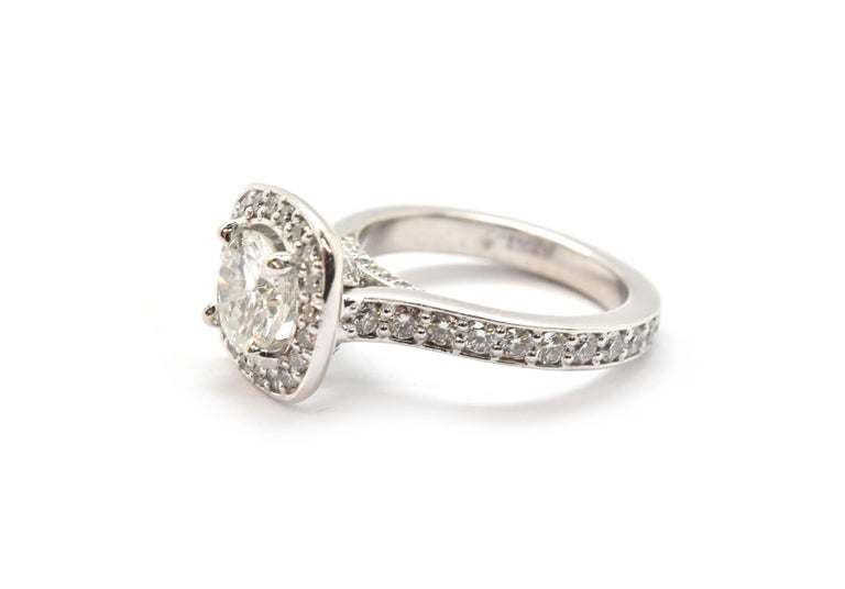 Round Cut Platinum Round 0.98 Carat Diamond Engagement Ring with Diamond Halo and Mounting For Sale