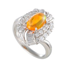 Platinum Round and Tapered Baguette Diamonds and Fire Opal Oval Ring