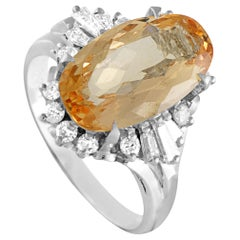 Platinum Round and Tapered Baguette Diamonds and Imperial Orange Oval Topaz Ring