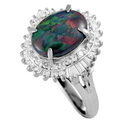 Platinum Round and Tapered Baguette Diamonds and Opal Oval Ring
