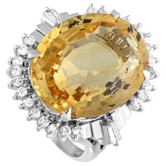 Platinum Round and Tapered Baguette Diamonds and Oval Citrine Ring