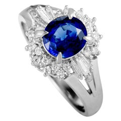 Platinum Round and Tapered Baguette Diamonds and Sapphire Ring