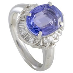 Platinum Round and Tapered Baguette Diamonds and Tanzanite Oval Ring