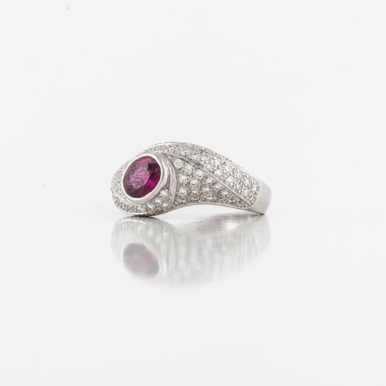 Rows of pave' diamonds are a gorgeous background for this ruby.  The ruby is oval and has a carat weight of 0.87.  There are a total of eighty-eight (88) diamonds totaling 0.63 carats.  Ring is crafted in platinum and is currently a size 6.
