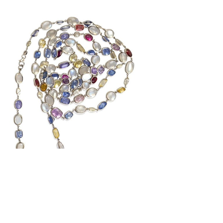 An American Contemporary platinum chain with 16 diamonds,61 sapphires and 34 moonstone. The chain has 16 oval diamonds with an approximate total weight of 6.00 carats, 61 sapphires with an approximate total weight of 33.00 carats, and 34 cabochon