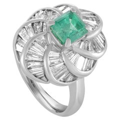 Platinum Tapered Baguette Diamonds and Emerald Oval Ring