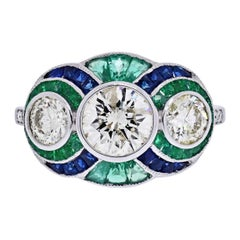 Platinum Three Stone Diamond, Emerald and Sapphire Three Stone Ring