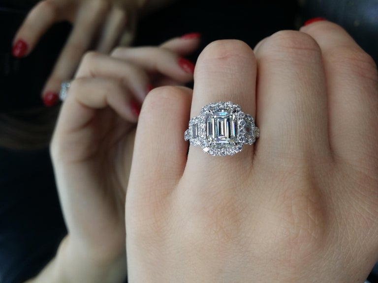 Platinum emerald cut diamond engagement ring, features 3.19 Carats of Diamonds, I in color SI1 in clarity. Set with two baguettes on the side totaling 1.50 Carats of diamonds.