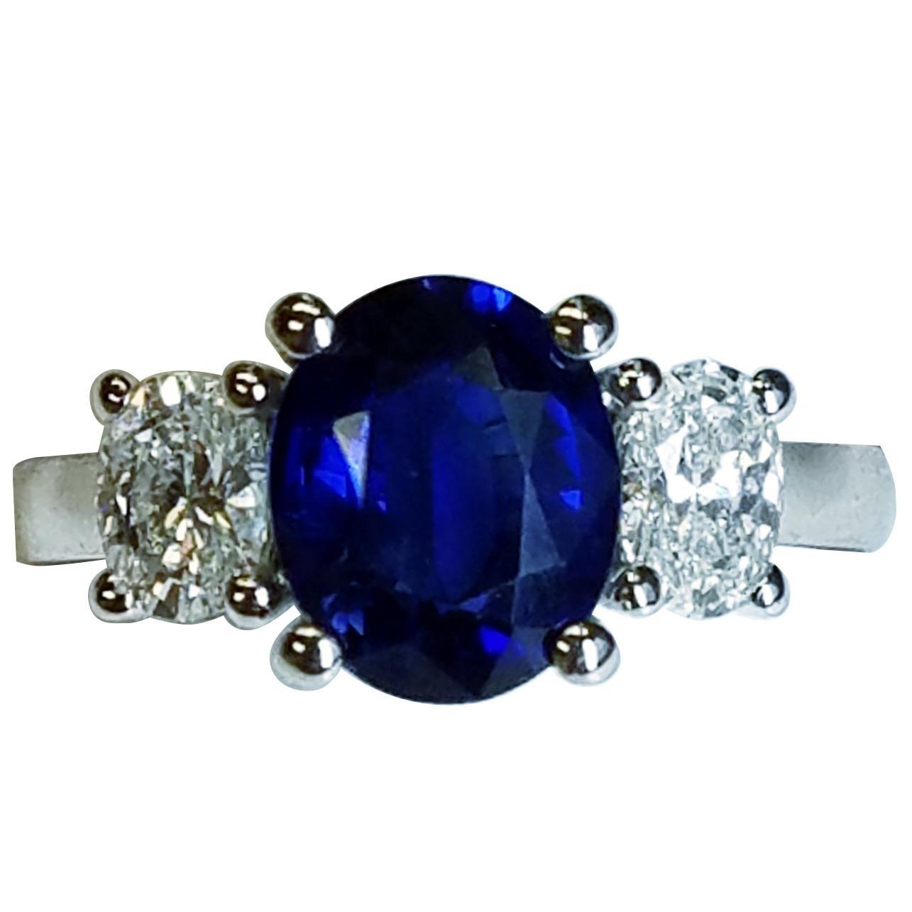 Platinum Three-Stone Oval Cut Blue Sapphire and Diamond Ring