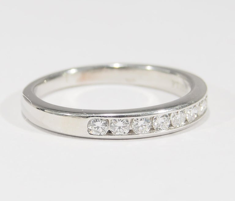 From the iconic jewelry designer, Tiffany & Company is this Platinum Diamond Band. The Ring is designed as a