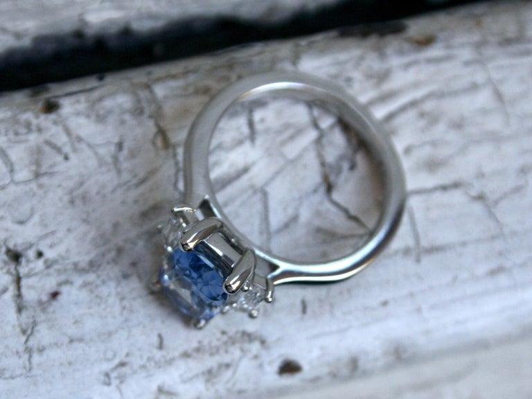 Cushion Cut Platinum Unheated Ceylon Sapphire Engagement Ring with Trapezoid Cut Diamonds For Sale