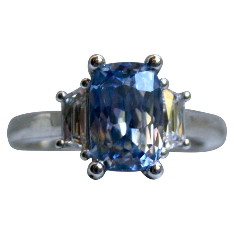 Platinum Unheated Ceylon Sapphire Engagement Ring with Trapezoid Cut Diamonds For Sale