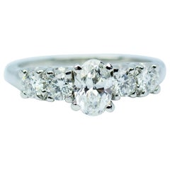 Platinum White Oval Diamond Center with Round White Diamond Ring