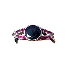 Platinum Womans Ring with Dark Sapphire, Rubies and Diamonds