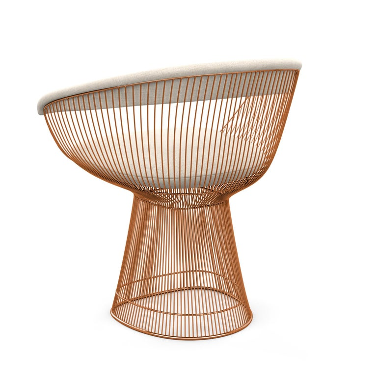 """In 1966, the Platner Collection captured the """"decorative, gentle, graceful"""" shapes that were beginning to infiltrate the modern vocabulary. The Arm Chair, which can be used as a dining chair or guest chair, is created by welding curved steel rods to"""