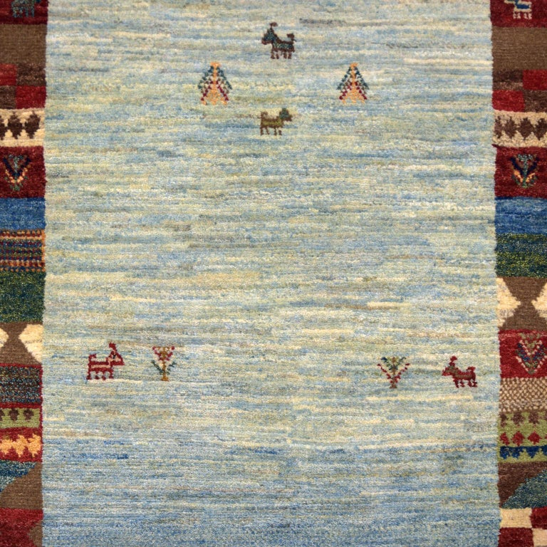 """Woven in Iran, this Persian carpet measures 2'8"""" x 4'4"""" and is part of Orley Shabahang's World Market Collection. To construct this carpet, the weaver utilized a Persian weaving technique. This hand-knotting technique originates from Persia and"""