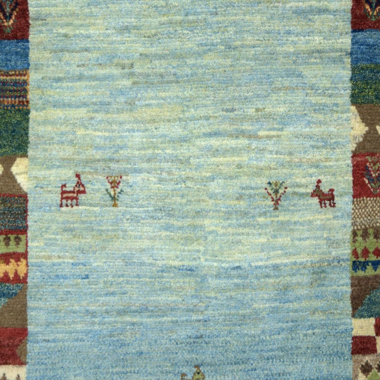 Vegetable Dyed Playful Blue, Cream, and Red Wool Kashkouli Tribal Persian Carpet For Sale