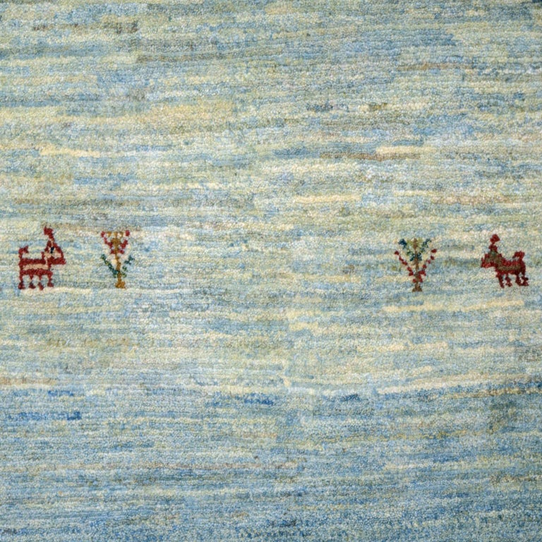 Playful Blue, Cream, and Red Wool Kashkouli Tribal Persian Carpet For Sale 1
