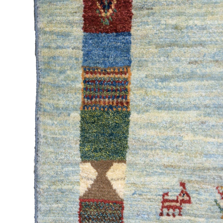 Playful Blue, Cream, and Red Wool Kashkouli Tribal Persian Carpet For Sale 2