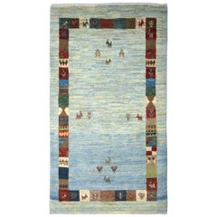 Playful Blue, Cream, and Red Wool Kashkouli Tribal Persian Carpet