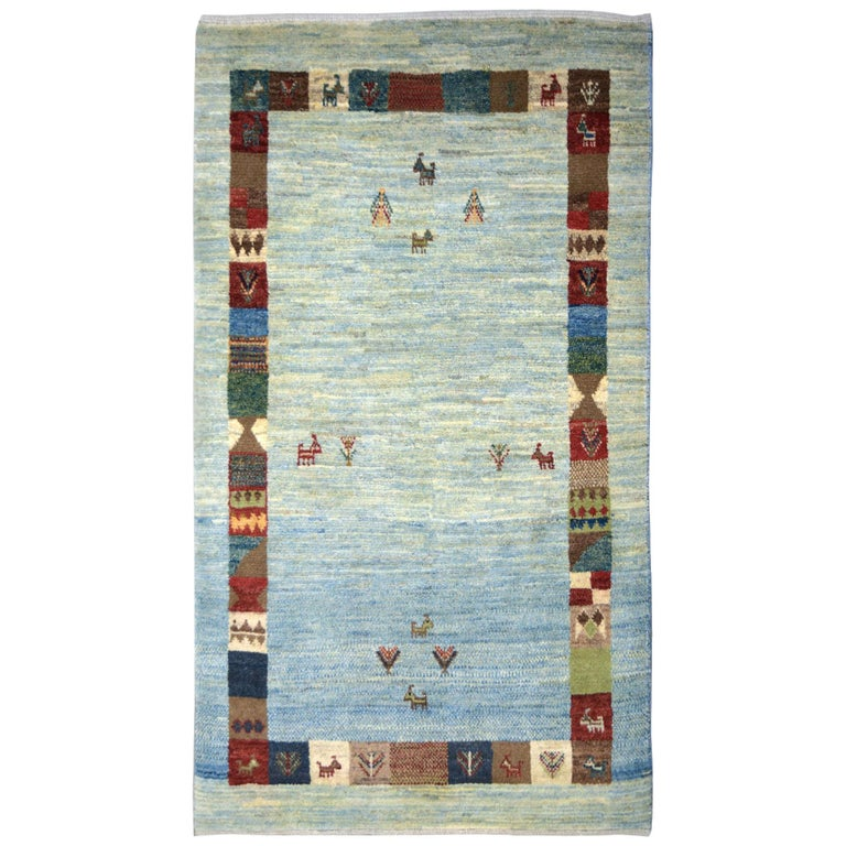 Playful Blue, Cream, and Red Wool Kashkouli Tribal Persian Carpet For Sale
