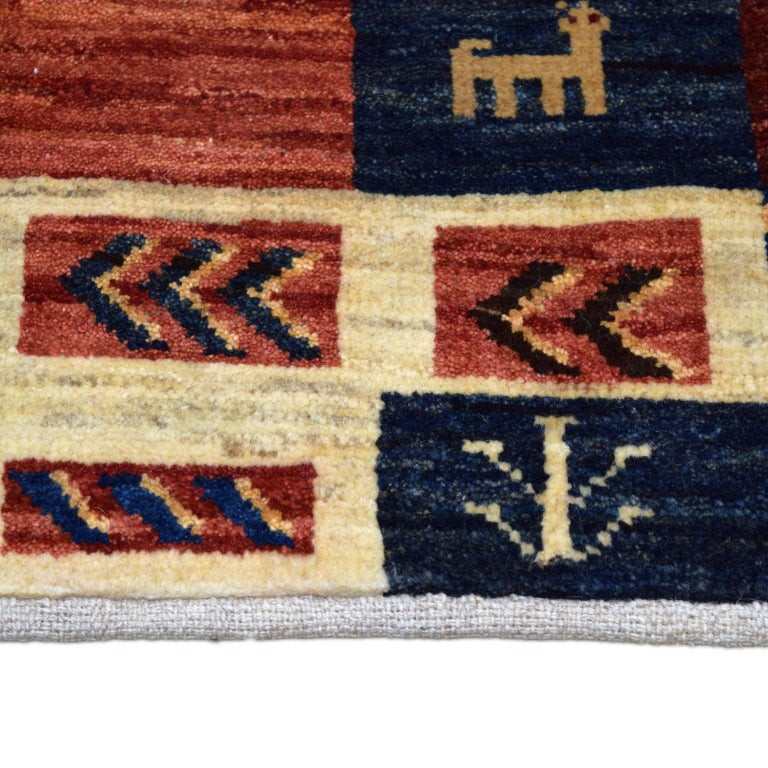 Vegetable Dyed Playful Red, Blue, Cream, and Gold Wool Persian Kashkouli Carpet For Sale