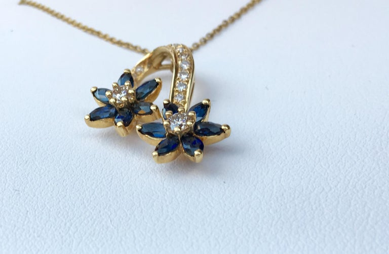Contemporary Playful Spinning Flowers Sapphire Diamond 18 Karat Yellow Gold Pendant on Chain For Sale