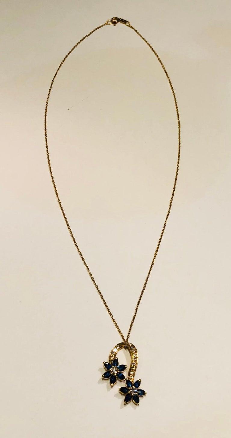 Pear Cut Playful Spinning Flowers Sapphire Diamond 18 Karat Yellow Gold Pendant on Chain For Sale