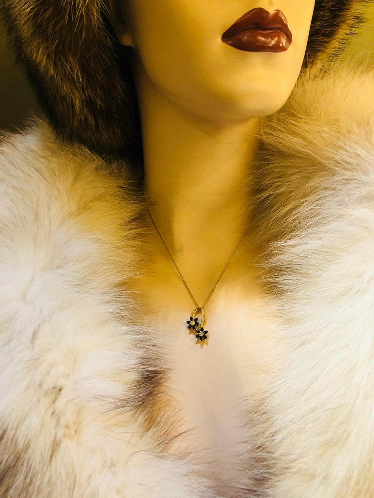 Playful Spinning Flowers Sapphire Diamond 18 Karat Yellow Gold Pendant on Chain For Sale 1