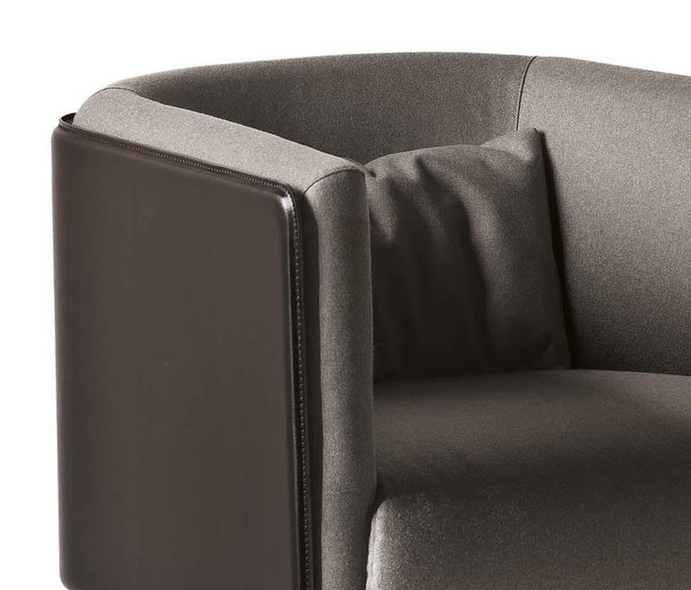The Mid-Century Modern inspiration of this barrel armchair will lend a curated accent to a broad variety of interiors, offering both sophistication and comfort. Founded on a wooden frame, this enveloping design features an arched backrest,